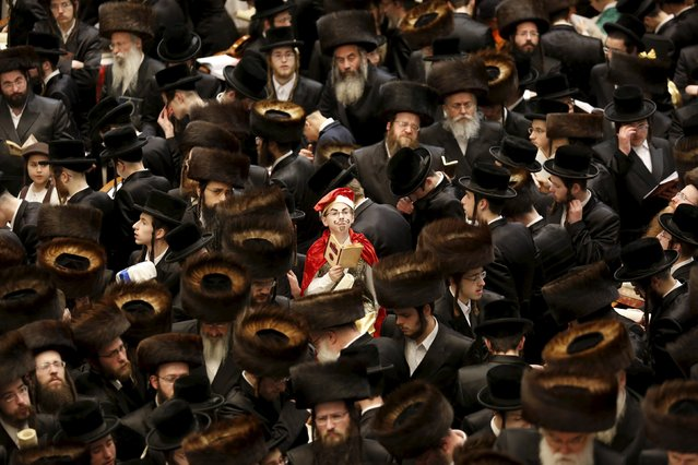 An Ultra-Orthodox Jewish boy (C) from the Belz Hasidic dynasty dressed in a Purim costume takes part in the reading from the Book of Esther ceremony performed on the Jewish holiday of Purim, in Jerusalem March 24, 2016. (Photo by Ronen Zvulun/Reuters)