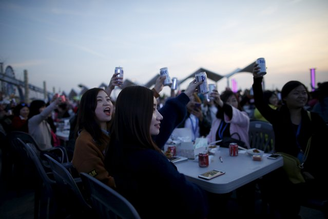Chinese tourists make a toast with cans of beer during an event organized by a Chinese company at a park in Incheon, South Korea, March 28, 2016. (Photo by Kim Hong-Ji/Reuters)