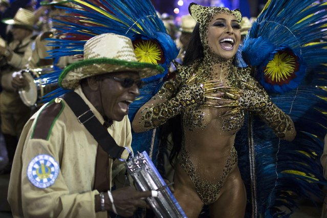 Drum Queen Sabrina Sato from the Vila Isabel samba school parades during carnival celebrations at the Sambadrome in Rio de Janeiro, Brazil, Tuesday, March 4, 2014. (Photo by Felipe Dana/AP Photo)