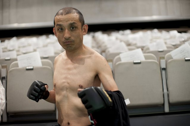"""Sambo"" Shintaro, Doglegs co-founder, and star of the documentary film Doglegs, strikes a fighting pose in Japan in this April 29, 2011 handout photo. Filmmaker Heath Cozens hopes to smash stereotypes about the disabled with his new documentary Doglegs, about a handicapped pro-wrestling league in Japan. (Photo by Alfie Goodrich/Reuters)"