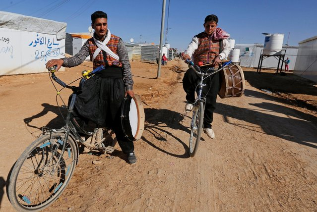 Members of the Syrian refugee folklore troupe Abu Rustom leave after performing at a wedding show at Zaatari refugee camp in the Jordanian city of Mafraq, near the border with Syria February 20, 2017. (Photo by Muhammad Hamed/Reuters)
