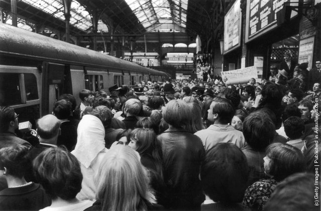 Fans of the pirate radio station, Radio London at Liverpool Street Station, London to protest at the governmentfs decision to outlaw offshore radio. Throughout the day, the stationfs disc jockeys, including Big L,  had asked fans to meet them at Liverpool Street after Radio London closed down