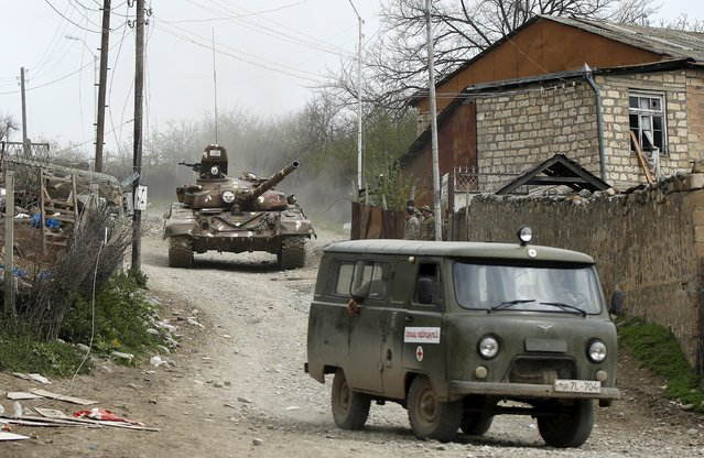 A tank of the self-defense army of Nagorno-Karabakh moves on the road in the village of Talish April 6, 2016. (Photo by Reuters/Staff)