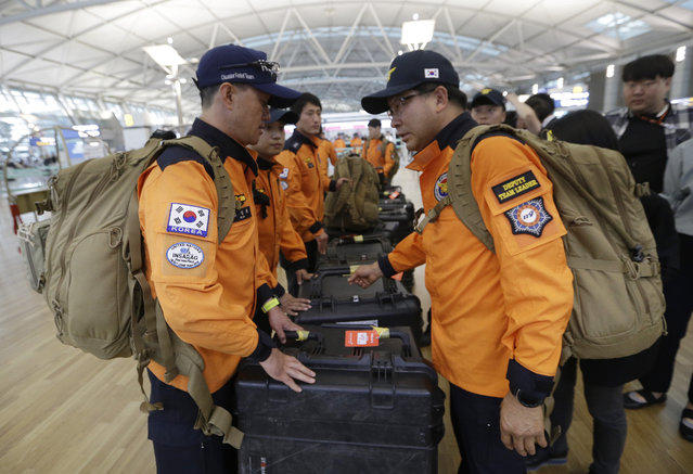 South Korean rescue team members prepare to board a plane to leave for Budapest at Incheon International Airport in Incheon, South Korea, Thursday, May 30, 2019. A massive search is underway on the Danube River in downtown Budapest for over a dozen people missing after a sightseeing boat with 33 South Korean tourists sank after colliding with another vessel during an evening downpour. (Photo by Ahn Young-joon/AP Photo)