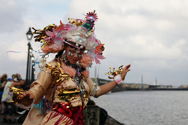 A woman celebrates Mardi Gras outside the French Quarter along the Mississippi river bank in New Orleans, Louisiana U.S., February 28, 2017. (Photo by Shannon Stapleton/Reuters)