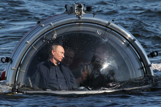 Russian President Vladimir Putin rides in a submersible July 15, 2013 in the Baltic Sea near Gotland Island, Russia. (Photo by Sasha Mordovets/Getty Images)