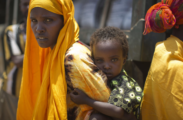 A woman and a child in the drought-affected village of Bandarero, near Moyale town on the Ethiopian border, in northern Kenya, Friday, March 3, 2017. (Photo by Ben Curtis/AP Photo)