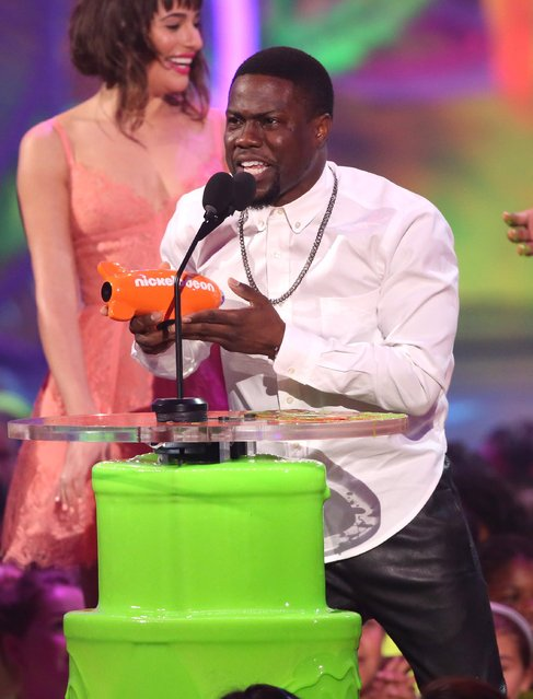 Kevin Hart accepts the award for favorite funny star at the 27th annual Kids' Choice Awards at the Galen Center on Saturday, March 29, 2014, in Los Angeles. (Photo by Matt Sayles/Invision/AP Photo)