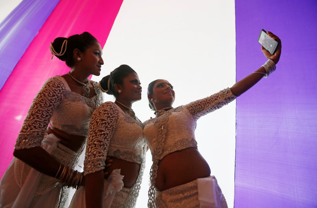 A group of female traditional dancers take selfies at the backstage during International Women's Day celebrations in Colombo, Sri Lanka, March 8, 2017. (Photo by Dinuka Liyanawatte/Reuters)
