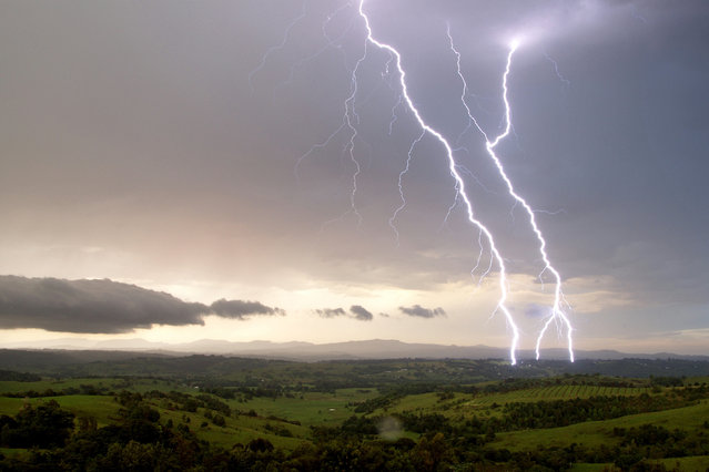 """Lightning Flash Photography"". Mcleans Ridges, New South Wales, Australia – December 3, 2008. (Photo by Michael Bath/Caters News)"