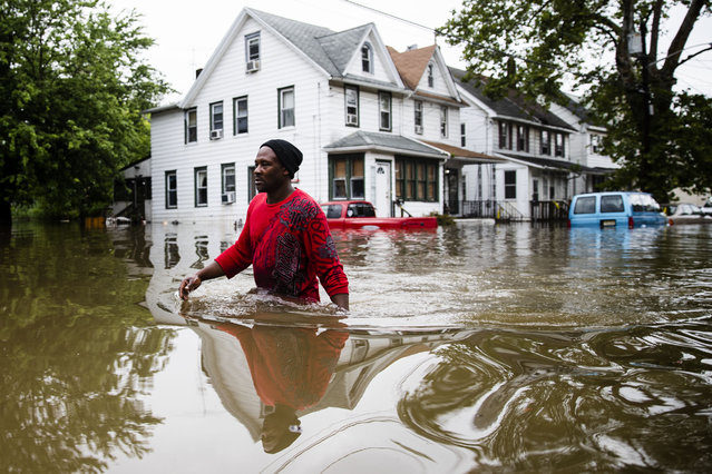 Chris Smith makes his way through floodwaters to the Macedonia Baptist Church in Westville, N.J., Thursday, June 20, 2019. Severe storms containing heavy rains and strong winds spurred flooding across southern New Jersey, disrupting travel and damaging some property. (Photo by Matt Rourke/AP Photo)