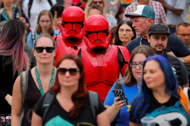 Attendees of the pop culture festival Comic Con International arrive in costume for opening night in San Diego, California, U.S., July 17, 2019. (Photo by Mike Blake/Reuters)