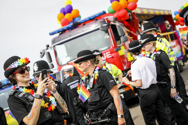 Police officers during Brighton Pride Parade on August 03, 2019 in Brighton, England. Tens of thousands of revellers dressed in rainbow colours and elaborate costumes and descended on the seaside city to ask for equality for all. (Photo by Tristan Fewings/Getty Images)