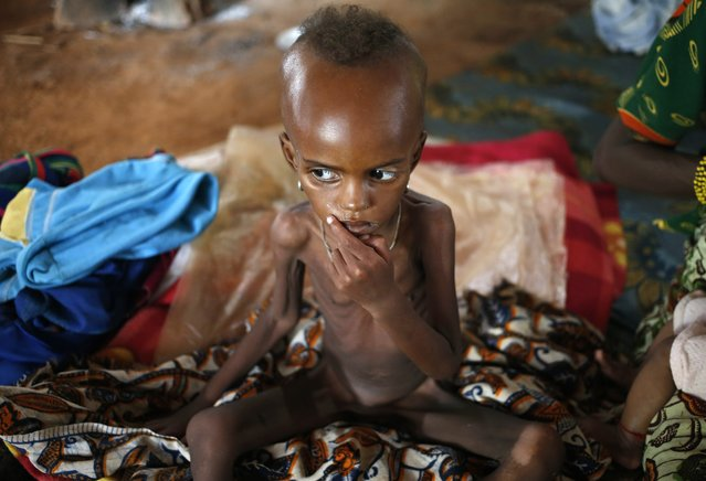 A sick internally displaced Muslim girl sits next to her mother in a house in the town of Boda April 15, 2014. (Photo by Goran Tomasevic/Reuters)