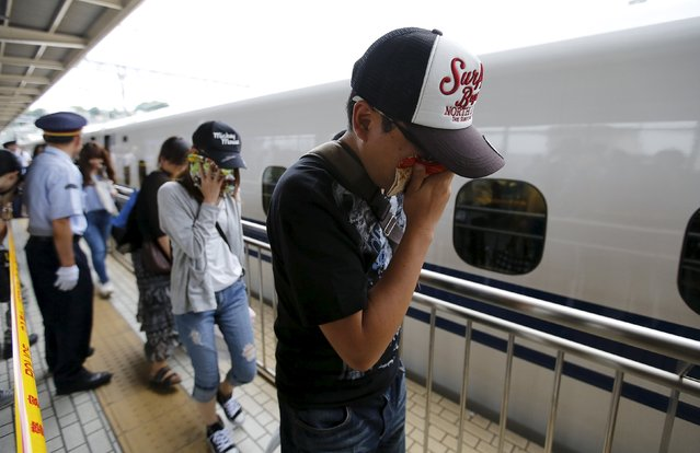 Passengers get off a Shinkansen bullet train at Odawara station after it made an emergency stop, in Odawara, west of Tokyo June 30, 2015. Two passengers on the Japanese Shinkansen bullet train died after one doused himself in oil and set himself ablaze on Tuesday, media reports said. The train, carrying about 1,000 passengers, made an emergency stop on its way from Tokyo to the western city of Osaka after smoke started to fill at least one carriage, fire department officials said. (Photo by Toru Hanai/Reuters)