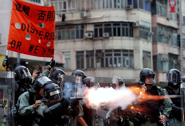 Police officers fire tear gas as anti-extradition bill protesters demonstrate in Sham Shui Po neighbourhood in Hong Kong, China, August 11, 2019. (Photo by Tyrone Siu/Reuters)