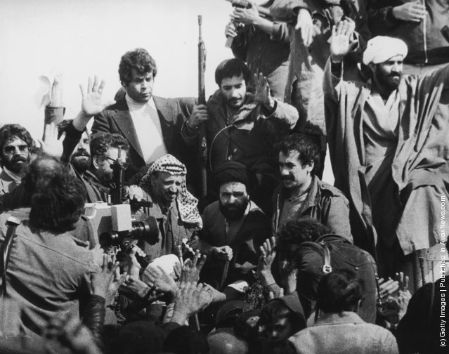 A television crew films PLO Chairman Yasser Arafat (centre, left) with Iranian revolutionaries at a cemetery in Tehran, February 1979. Arafat was the first foreign dignitary to visit the post-revolutionary Iran of Ayatollah Khomeini