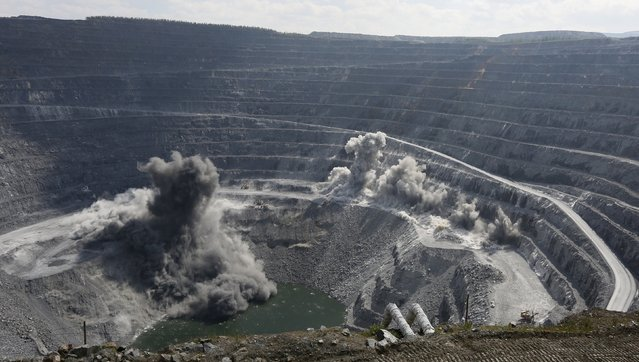 A view shows explosions, part of the mining technology, at the 550-metre-deep Vostochny opencast of the Olimpiada gold operation, owned by Polyus Gold International company, in Krasnoyarsk region, Eastern Siberia, Russia, June 30, 2015. (Photo by Ilya Naymushin/Reuters)