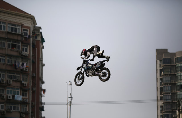 A competitor performs in the FMX Course competition during the World Extreme Games in Shanghai April 30, 2014. The games will be held in Shanghai until May 3. (Photo by Carlos Barria/Reuters)