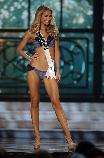 Miss Oklahoma, Olivia Jordan, competes in the bathing suit competition during the preliminary round of the 2015 Miss USA Pageant in Baton Rouge, La., Wednesday, July 8, 2015. (Photo by Gerald Herbert/AP Photo)