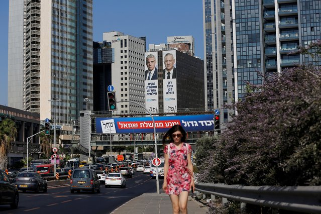 """Yair Lapid and Benny Gantz, leaders of Blue and White party, are depicted on their party election campaign banners in Tel Aviv, Israel on September 16, 2019. Israeli Prime Minister Benjamin Netanyahu said he was waiting for results in the country's general election, but that he was prepared for negotiations to form a """"strong Zionist government"""". He spoke as exit polls showed a tight race between his right-wing Likud and ex-military chief Benny Gantz's centrist Blue and White alliance. (Photo by Corinna Kern/Reuters)"""
