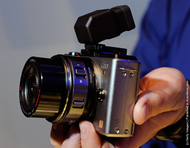 The Lumix GX1 single lens reflex (SLR) camera with 14-42 mm powerzoom lens is displayed at the Panasonic booth at the 2012 International Consumer Electronics Show