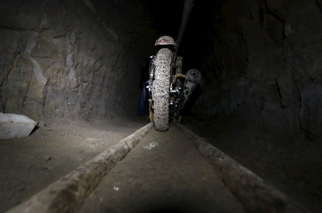 """A motorcycle modified to run on rails is seen inside a tunnel connected to the Altiplano Federal Penitentiary and used by drug lord Joaquin """"El Chapo"""" Guzman to escape, in Almoloya de Juarez, on the outskirts of Mexico City, July 15, 2015. (Photo by Edgard Garrido/Reuters)"""