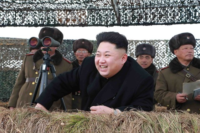 North Korean leader Kim Jong Un laughs as he watch a winter river-crossing attack drill of the armored infantry sub-units of the motorized strike group in the western sector of the front of the Korean People's Army (KPA) in this undated photo released by North Korea's Korean Central News Agency (KCNA) in Pyongyang January 27, 2015. (Photo by Reuters/KCNA)