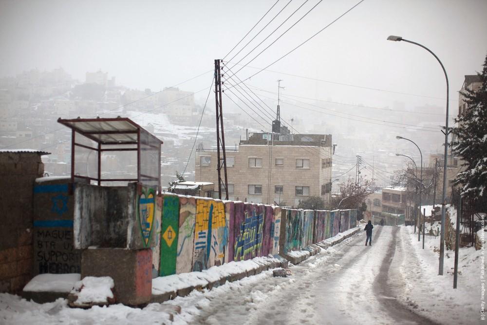 Snow Falls on Jerusalem and Hebron