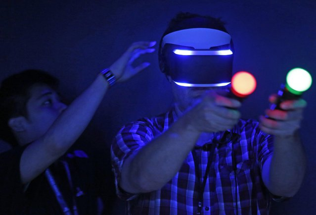 "Paul Breakhow tries out the Sony ""Project Morpheus"" virtual reality system at the 2014 Electronic Entertainment Expo, known as E3, in Los Angeles, June 10, 2014.  REUTERS/Jonathan Alcorn"