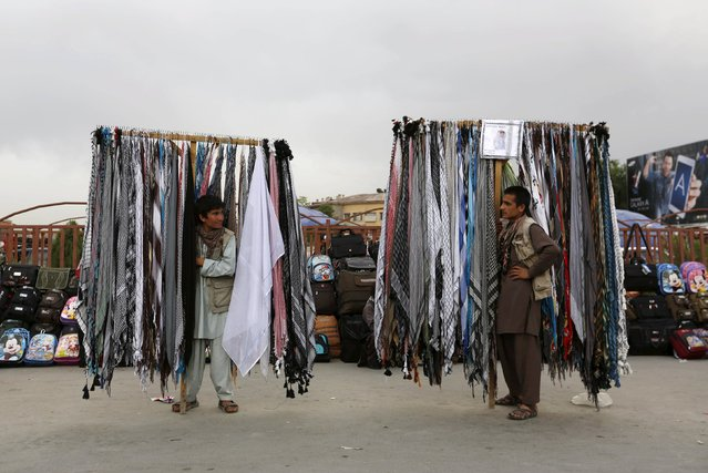 Afghan men sell scarves as they wait for customers in Kabul, Afghanistan, May 7, 2015. (Photo by Mohammad Ismail/Reuters)