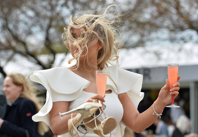 A racegoer on ladies day during the 2.20 Betway Top Novices' Hurdle at the Grand National Horse Racing Festival at Aintree Racecourse, near Liverpool, England on April 5, 2019. (Photo by Peter Powell/Reuters)