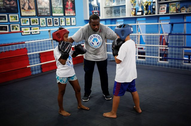 For many young residents the Luta Pela Paz (Fight For Peace) academy offers a glimpse of an alternative: a chance to build discipline and self-esteem through boxing and martial arts. Backed by partners including financial services company Credit Suisse and sportswear maker Reebok, it has more than 1,000 students between 7 and 29 years old. (Photo by Nacho Doce/Reuters)