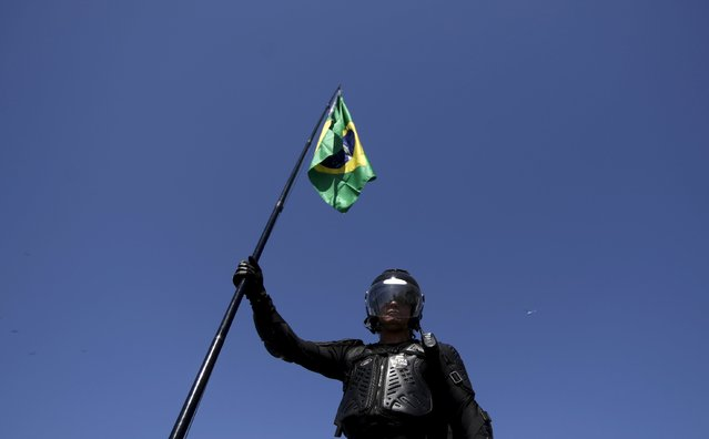 A demonstrator attends a protest against Brazil's President Dilma Rousseff, part of nationwide protests calling for her impeachment, in Copacabana in Rio de Janeiro, Brazil August 16, 2015. (Photo by Ricardo Moraes/Reuters)