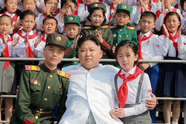 "Schoolchildren stand beside North Korean leader Kim Jong Un as he arrives to attend ""We Are the Happiest in the World"", a performance of schoolchildren to celebrate the 70th founding anniversary of the Korean Children's Union (KCU), in this undated photo released by North Korea's Korean Central News Agency (KCNA) in Pyongyang June 8, 2016. (Photo by Reuters/KCNA)"