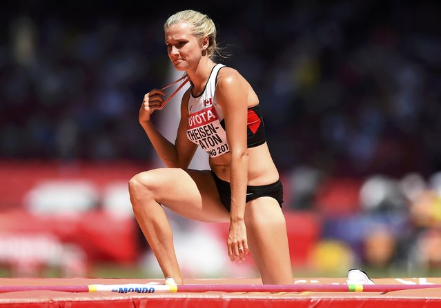 Brianne Theisen Eaton of Canada reacts as she competes in the high jump event of the women's heptathlon during the 15th IAAF World Championships at the National Stadium in Beijing, China, August 22, 2015. (Photo by Dylan Martinez/Reuters)