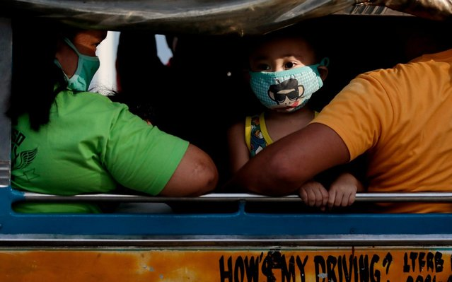 A boy wears a protective face mask with a character design inside a jeepney, following two confirmed cases of coronavirus in the country, in Quezon City, Metro Manila, Philippines, February 4, 2020. (Photo by Eloisa Lopez/Reuters)