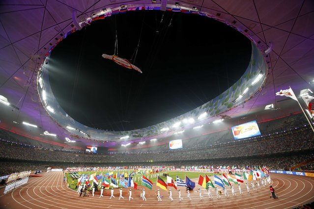 Flagbearers take part in the closing ceremony of the 15th IAAF Championships at the National Stadium in Beijing, China August 30, 2015. (Photo by David Gray/Reuters)