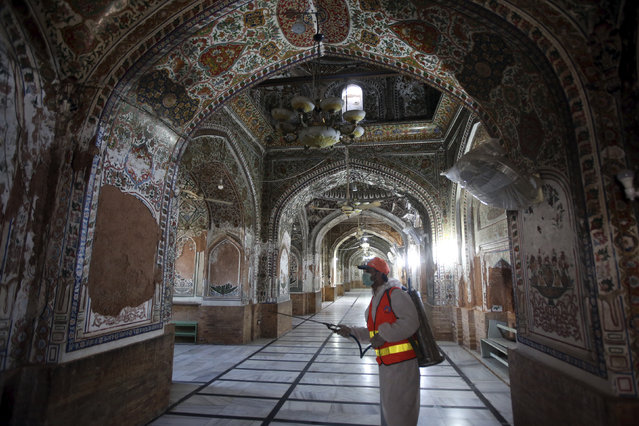 A worker disinfects a mosque for coronavirus, in Peshawar, Pakistan, Thursday, April 2, 2020. The government imposed a nationwide lockdown to try to contain the outbreak of the virus. (Photo by Muhammad Sajjad/AP Photo)