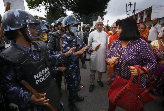 Nepalese supporters of Hindu religion and police scuffle during a protest rally in Kathmandu, Nepal, 01 September 2015. Hindu supporters from various religious organizations and political parties staged a protest rally demanding Nepal to be declared as a Hindu Nation in the new proposed constitution, which it is scheduled to be announced later this month. (Photo by Narendra Shrestha/EPA)