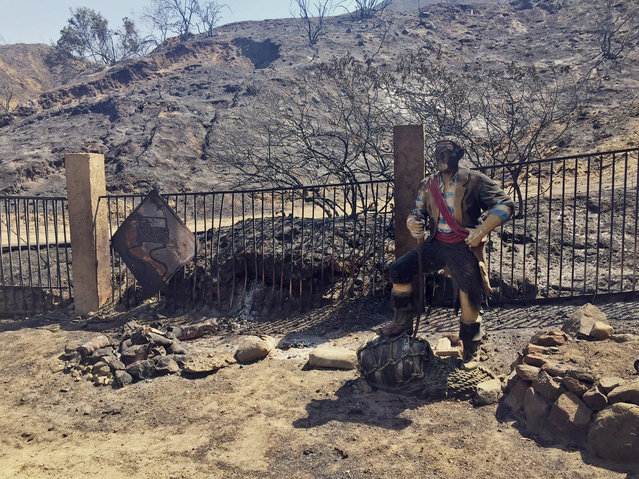 A burned pirate sculpture stands at the end of Iron Canyon Road off of Sand Canyon in Santa Clarita, Calif., on Sunday, July 24, 2016. (Photo by Matt Hartman/AP Photo)