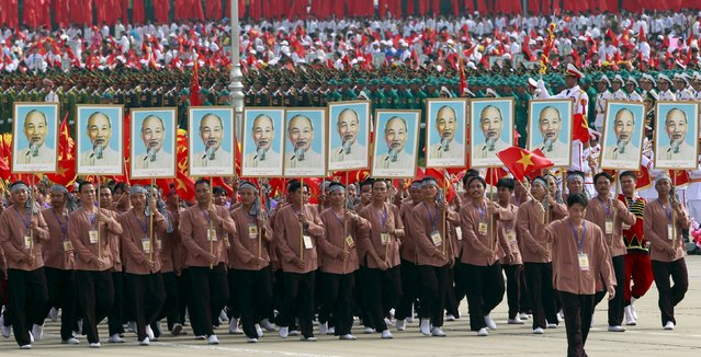 Farmers carry portraits of late Vietnamese revolutionary leader Ho Chi Minh during a parade marking their 70th National Day at Ba Dinh square in Hanoi, Vietnam September 2, 2015. (Photo by Reuters/Kham)