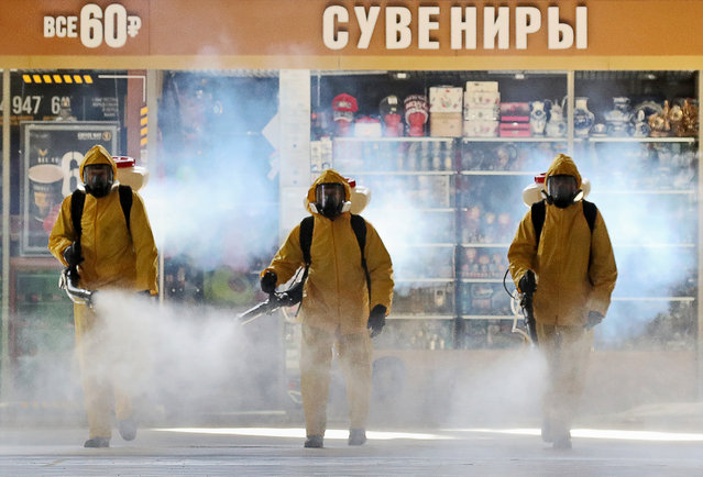 Russian Emergency Situations Ministry employees carry out disinfection of Kiyevsky Railway Station amid the COVID-19 coronavirus pandemic in Moscow, Russia on May 18, 2020. (Photo by Vyacheslav Prokofyev/TASS)