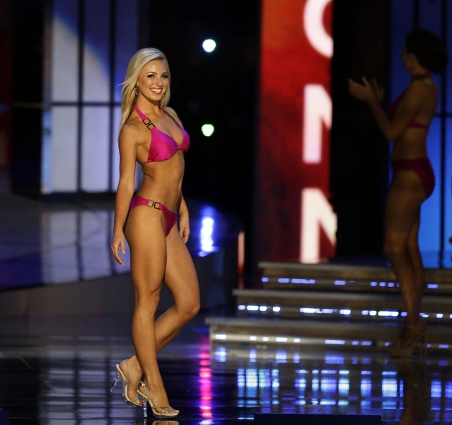 Miss Florida Victoria Cowen displays her swimsuit during the Miss America 2015 pageant, on September 14, 2014. (Photo by Mel Evans/AP Photo)