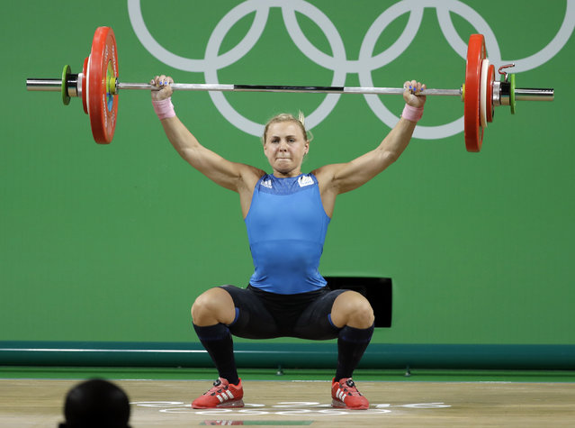 Angelica Roos, of Sweden, competes in the women's 58kg weightlifting competition at the 2016 Summer Olympics in Rio de Janeiro, Brazil, Monday, August 8, 2016. (Photo by Mike Groll/AP Photo)
