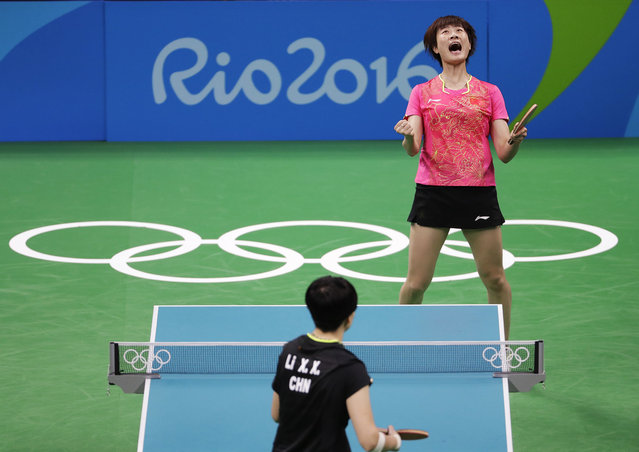 Ding Ning, of China, top, reacts after defeating Li Xiaoxia, of China, in the women's singles table tennis gold medal match at the 2016 Summer Olympics in Rio de Janeiro, Brazil, Wednesday, August 10, 2016. (Photo by David Goldman/AP Photo)