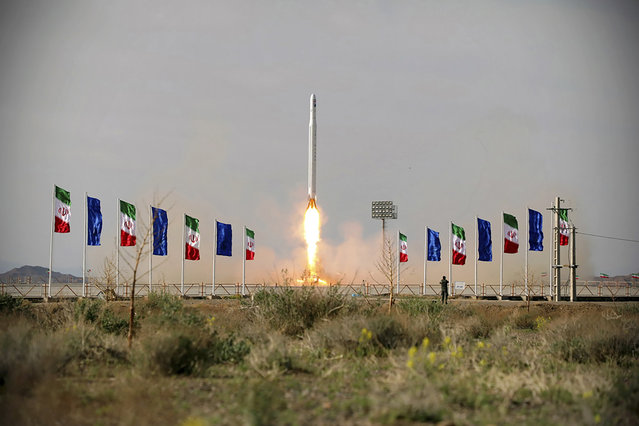 In this photo released Wednesday, April 22, 2020, by Sepahnews, an Iranian rocket carrying a satellite is launched from an undisclosed site believed to be in Iran's Semnan province. Iran's Revolutionary Guard said Wednesday it put the Islamic Republic's first military satellite into orbit, dramatically unveiling what experts described as a secret space program with a surprise launch that came amid wider tensions with the United States. (Photo by Sepahnews via AP Photo)