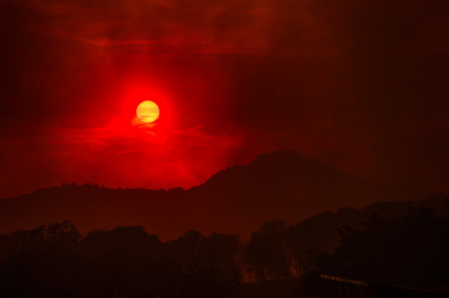 In this photo taken on Thursday, September 10, 2015, smoke from the Butte fire casts red and orange hues through the sky at Mokelumne Hill, in Jackson, Calif. (Photo by Andrew Sent/The Sacramento Bee via AP Photo)