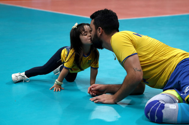 William Arjona of Brazil celebrates victory over Russia with his daughter following the Men's Volleyball Semifinal match on Day 14 of the Rio 2016 Olympic Games at the Maracanazinho on August 19, 2016 in Rio de Janeiro, Brazil. (Photo by Patrick Smith/Getty Images)