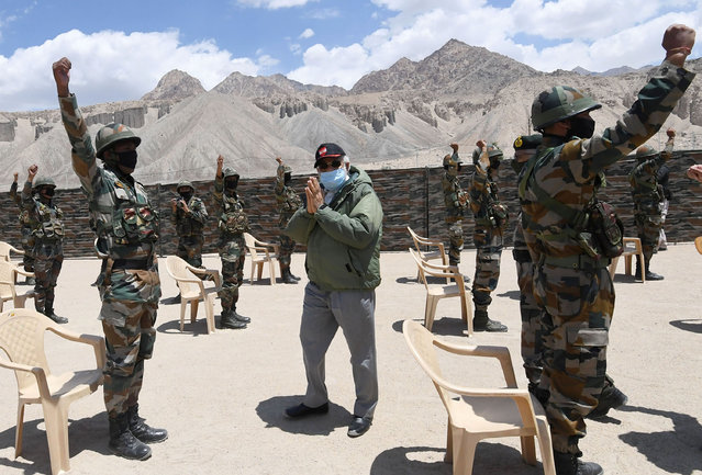In this handout photo provided by the Press Information Bureau, Indian Prime Minister Narendra Modi greets soldiers during a visit to Nimu, Ladakh area, India, Friday, July 3, 2020. (Photo by Press Information Bureau via AP Photo)